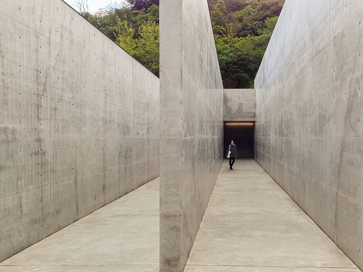 Entering through the high concrete walls at the Tadao Ando designed Lee Ufan Museum on Naoshima