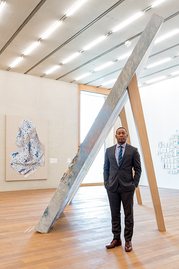 Franklin Sirmans in front of works by Firelei Baez at the Perez